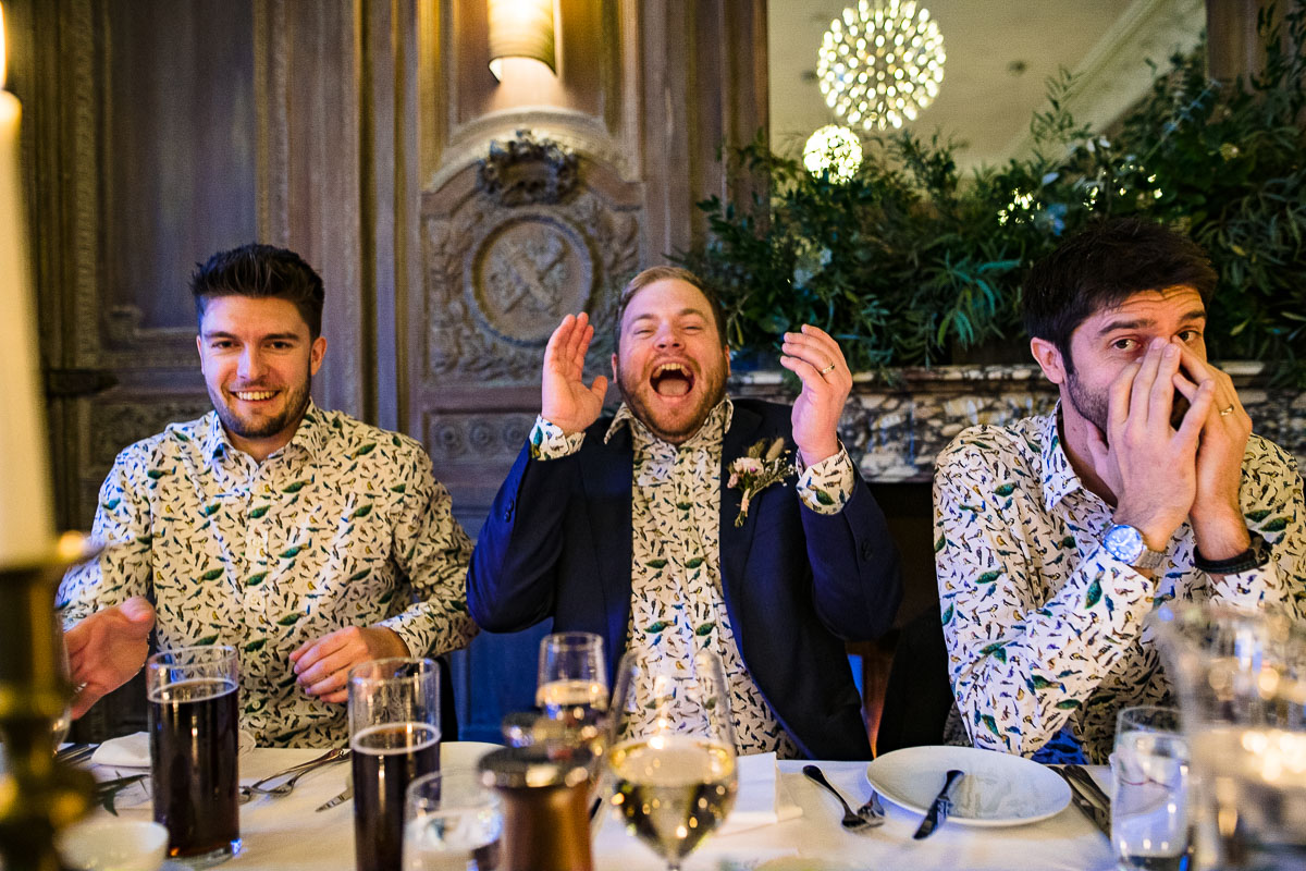 groomsmen laughing top table wedding speech