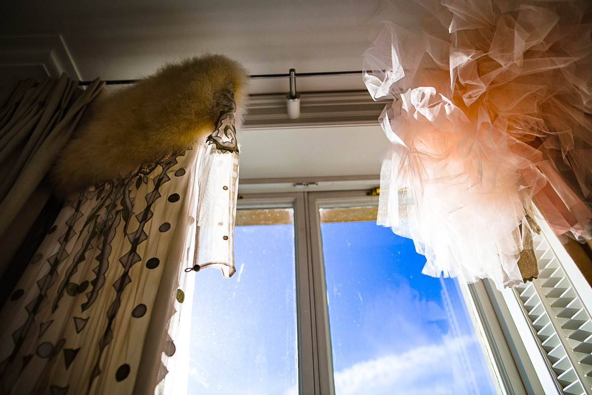 Winter wedding dress hanging window detail