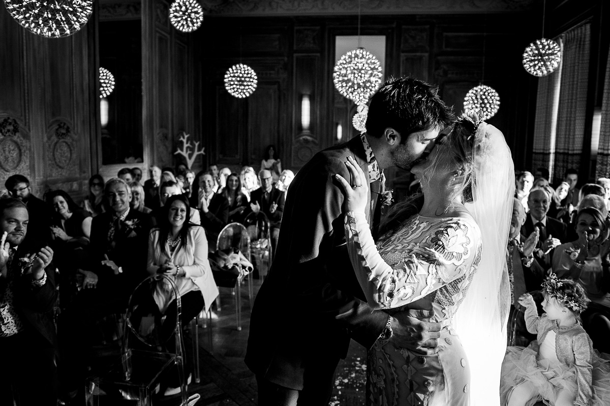 bride and groom first kiss Cowley manor wedding