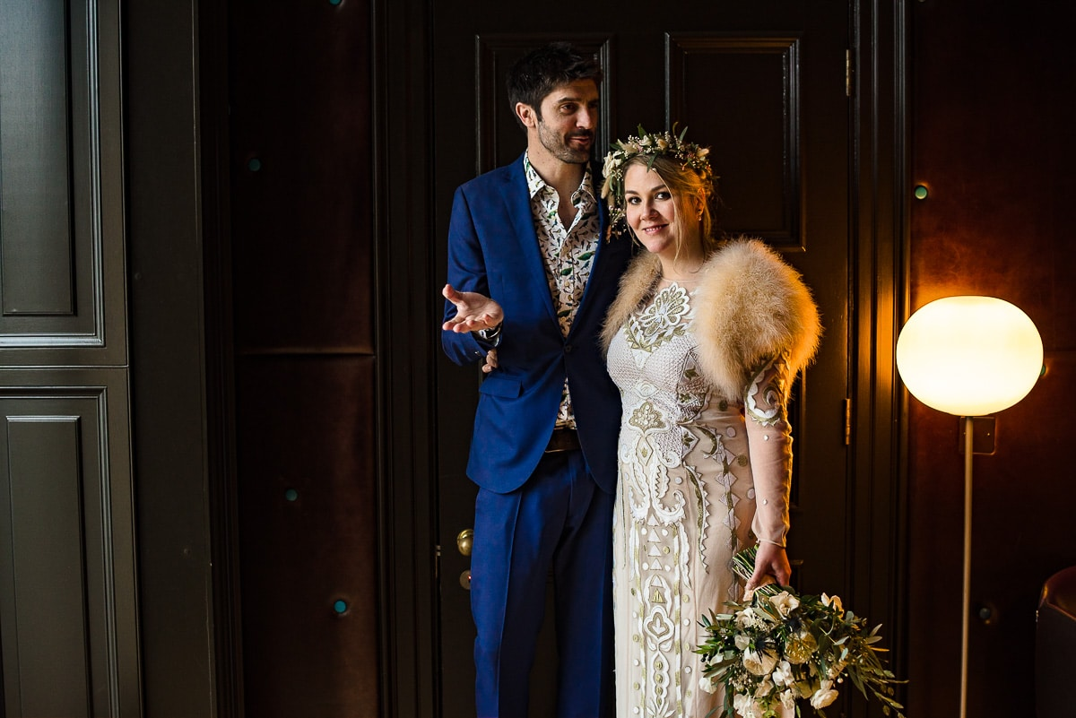 bride groom winter wedding dress interior Cowley Manor wedding photos