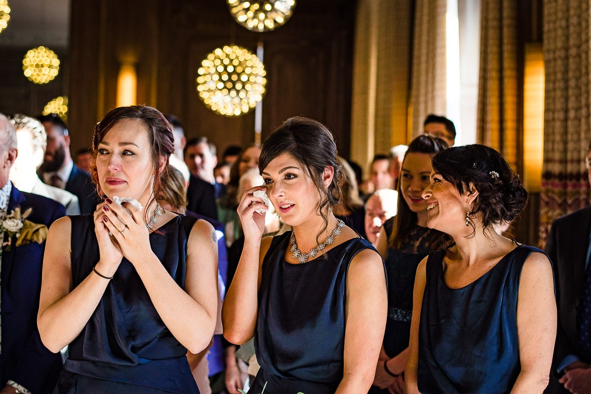 emotional bridesmaids wipe away tears tissue Cowley manor wedding