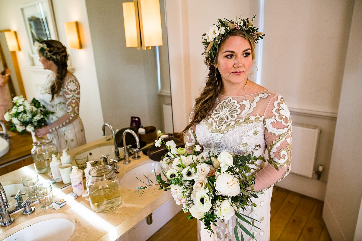 bride Cowley manor bathroom bouquet flower crown