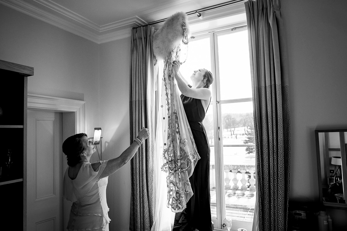 wedding dress hanging window Cowley Manor
