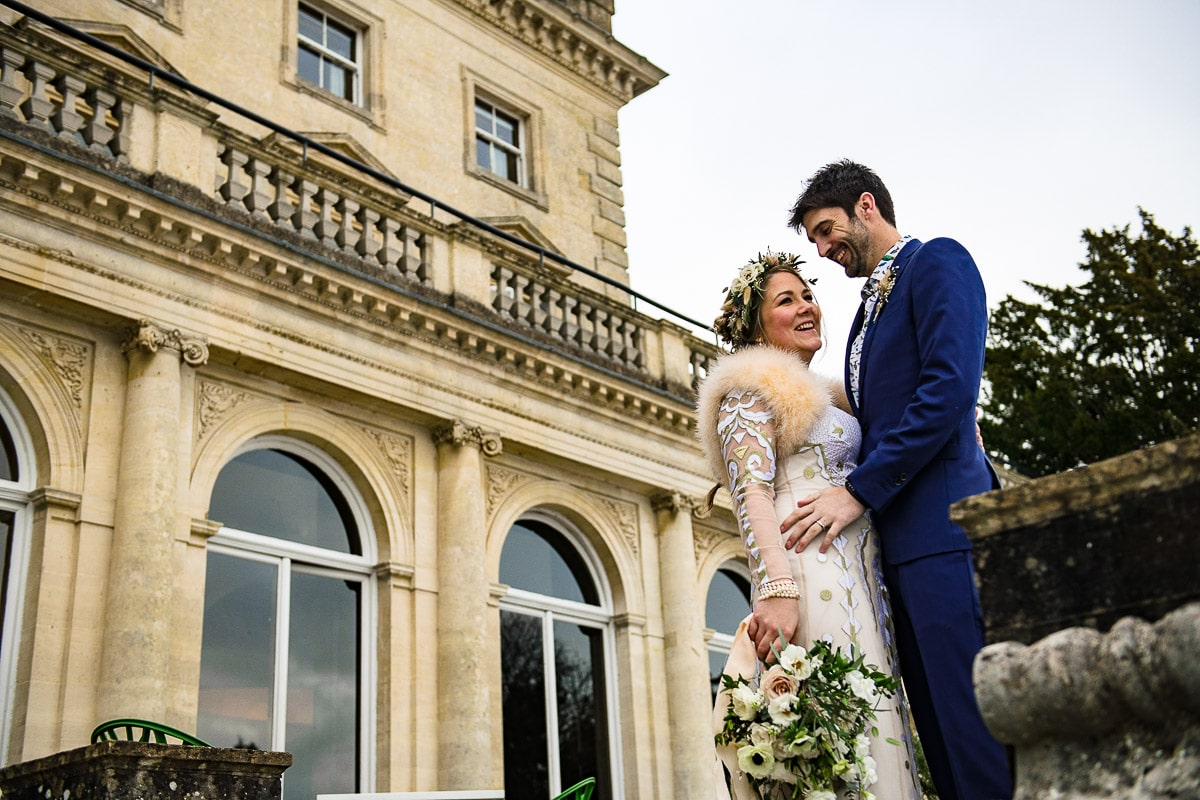 bride and groom winter wedding at cowley manor