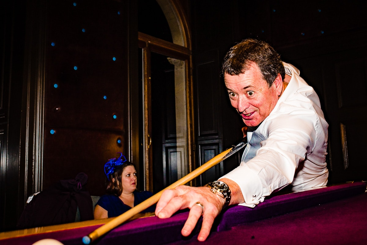 Playing pool in bar Cowley Manor wedding