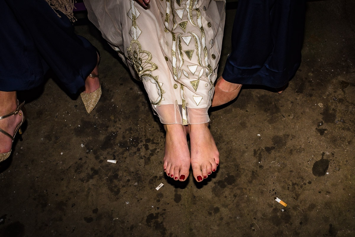 brides bare feet on stone floor photo