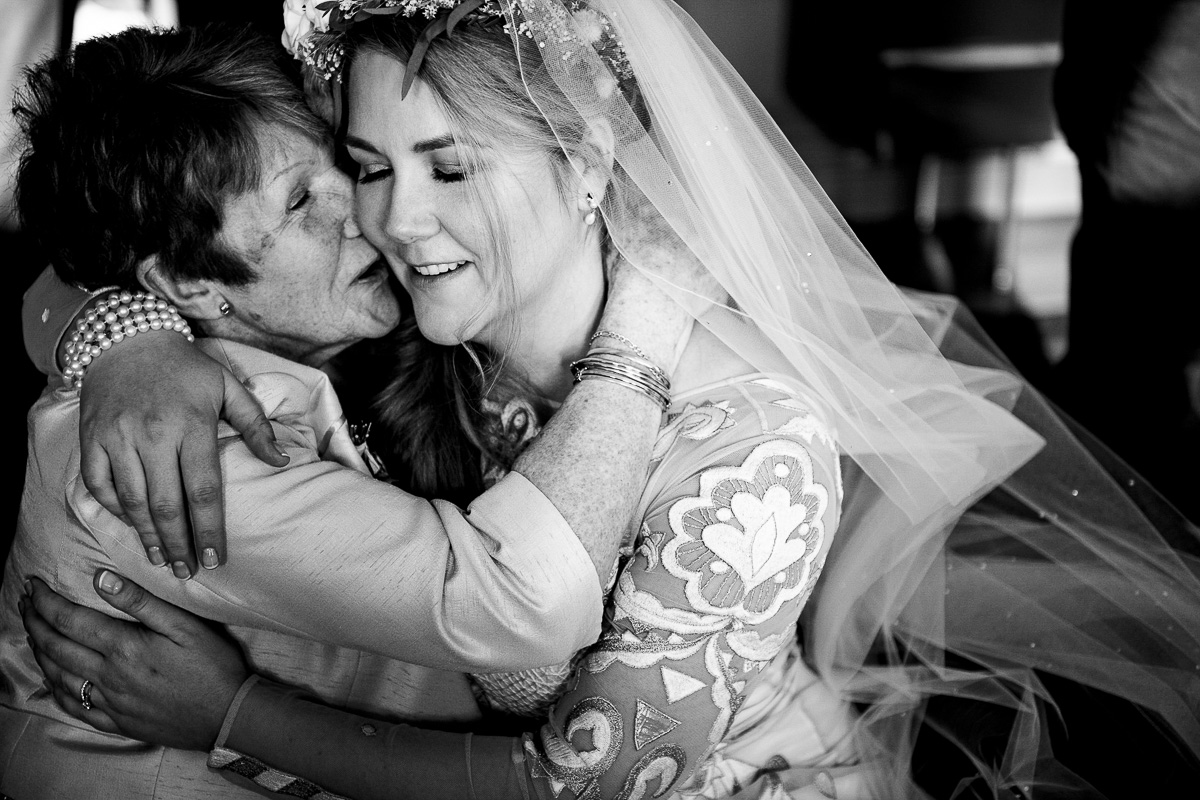 bride emotional hug grandma Cowley Manor wedding