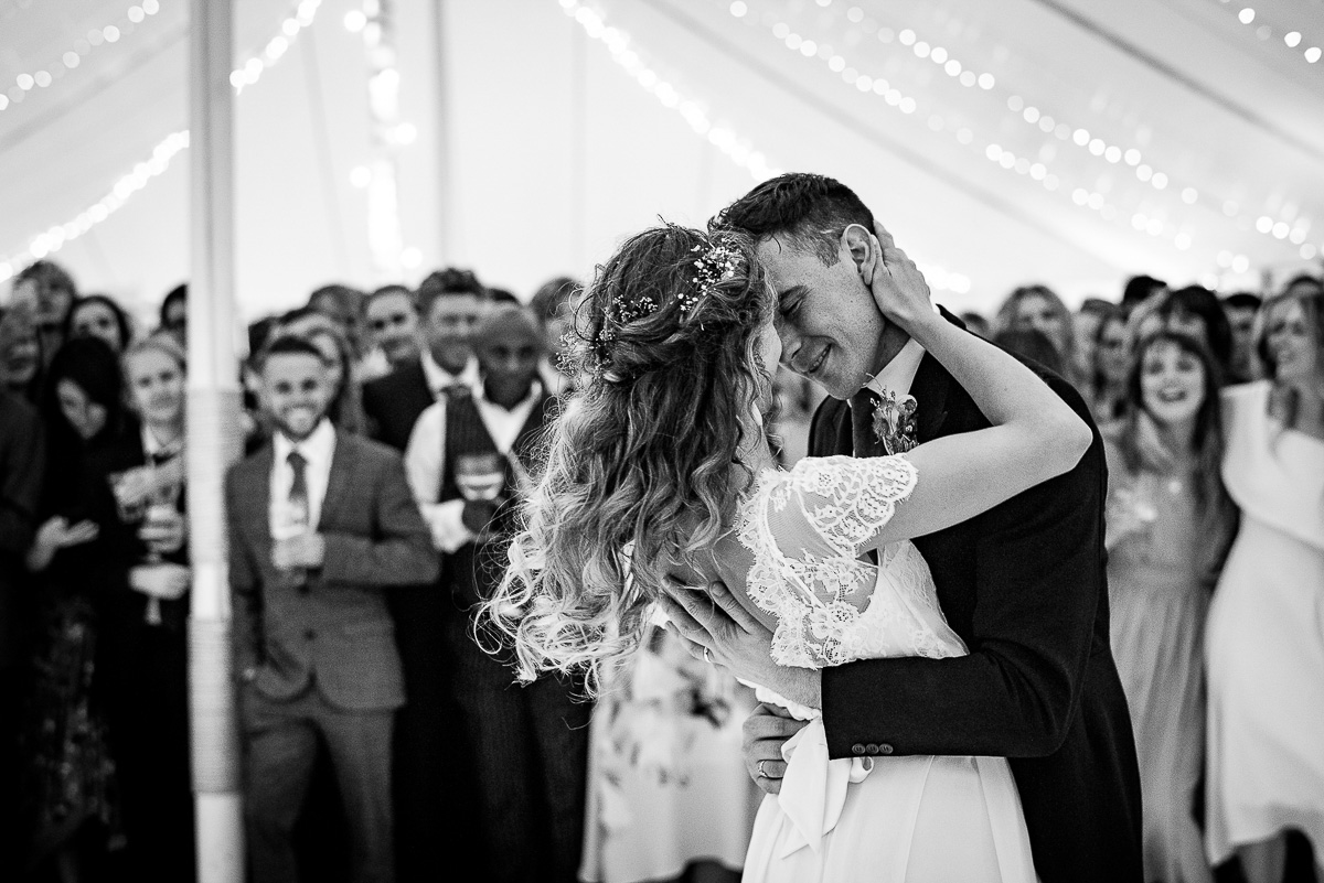 bride and groom embrace while they share first dance