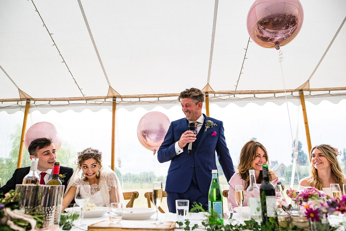 guests grin at embarrassing wedding speech