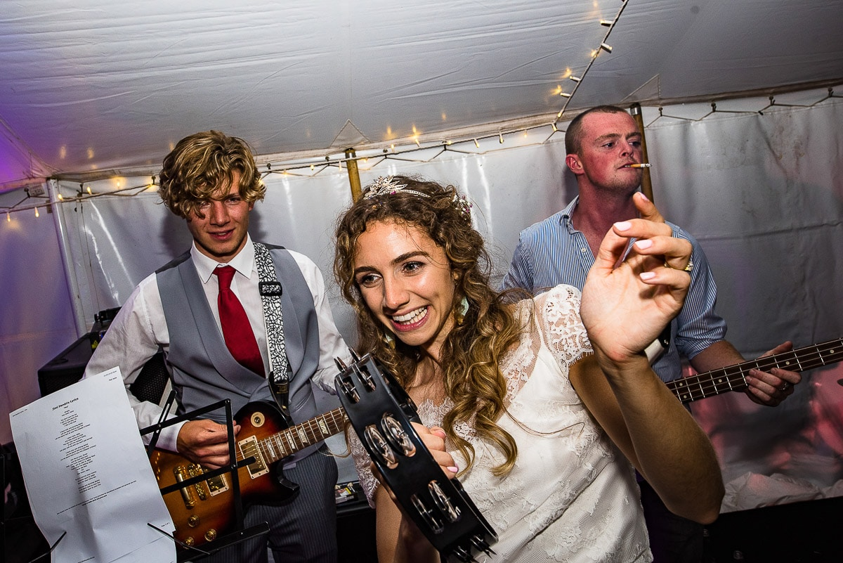 bride laughs as she joins band with music
