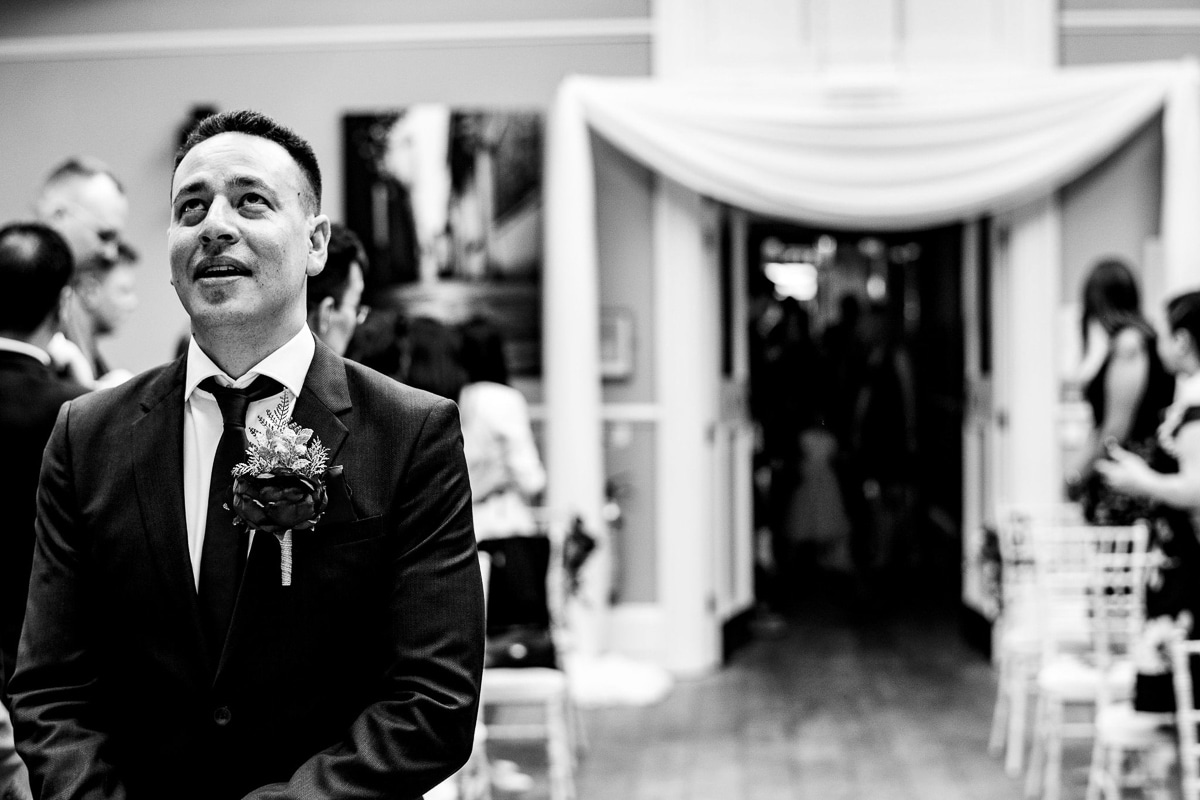 groom patiently awaits bride at alter portrait