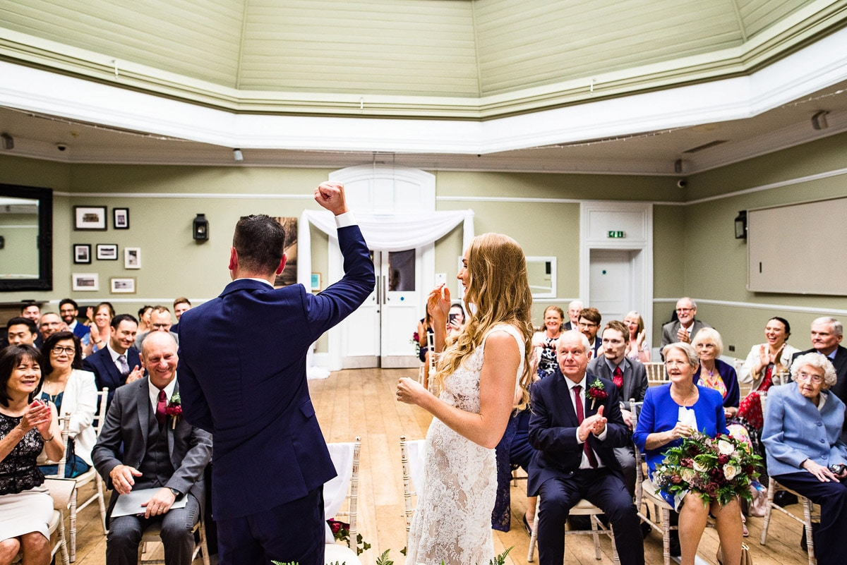guests clap as couple are announced husband and wife