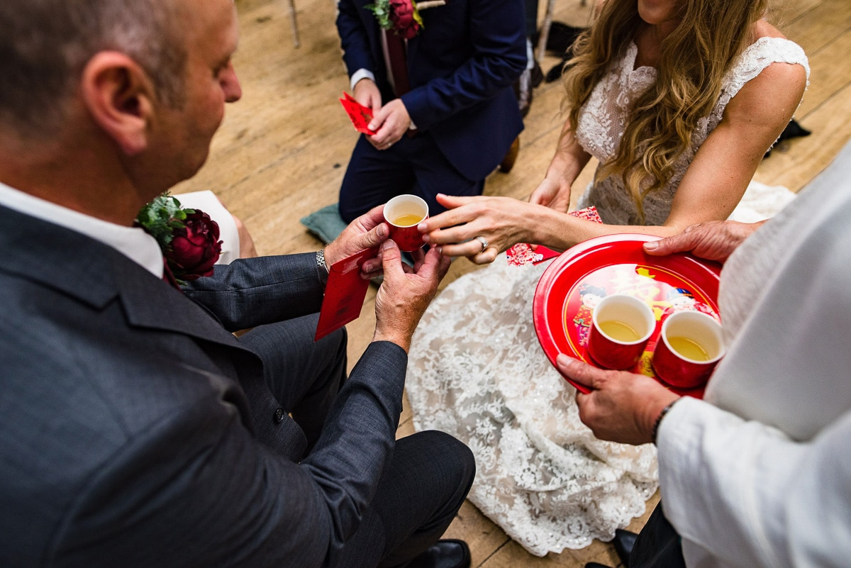tea being passed to wedding guests