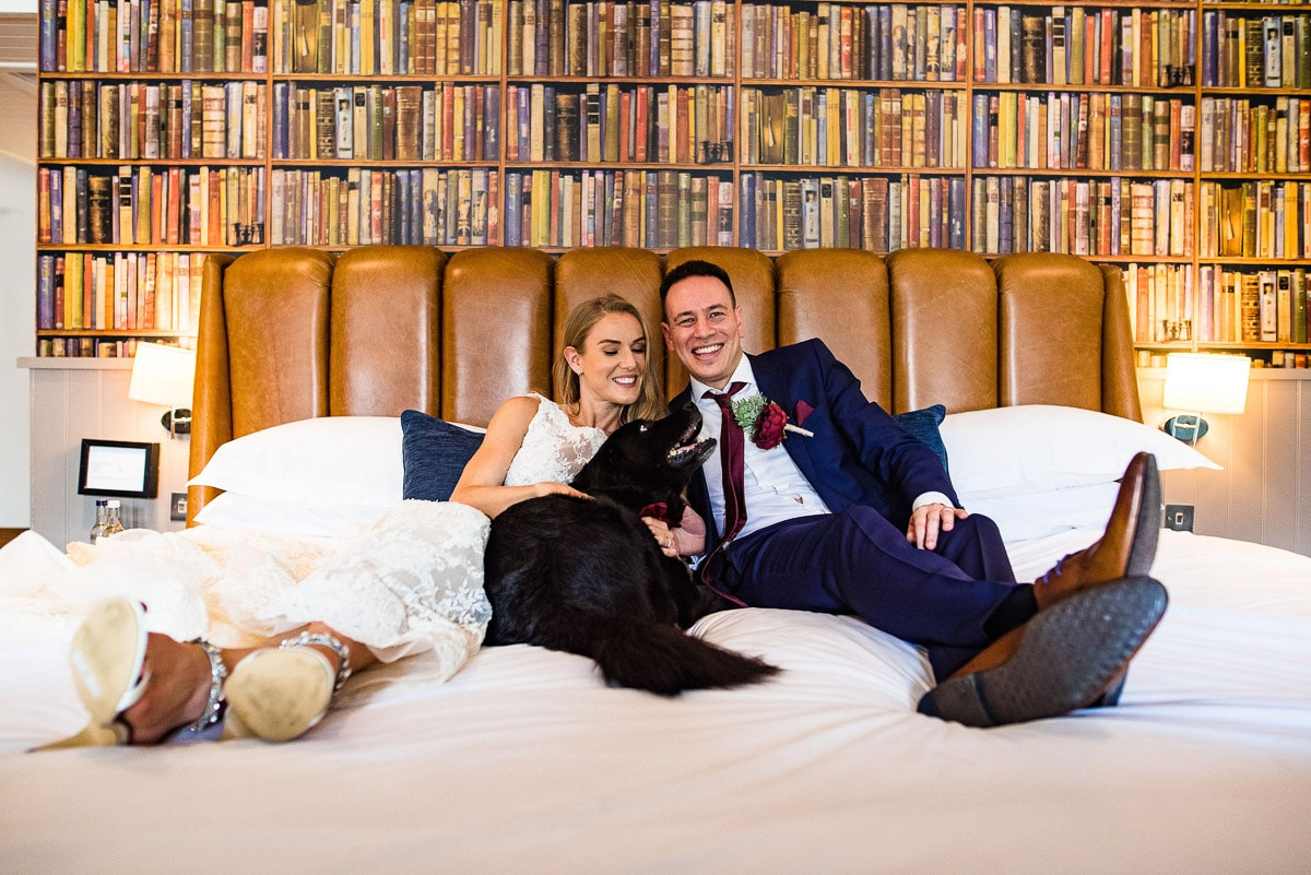 bride and groom lay on bed at Pub Du Vin Brighton