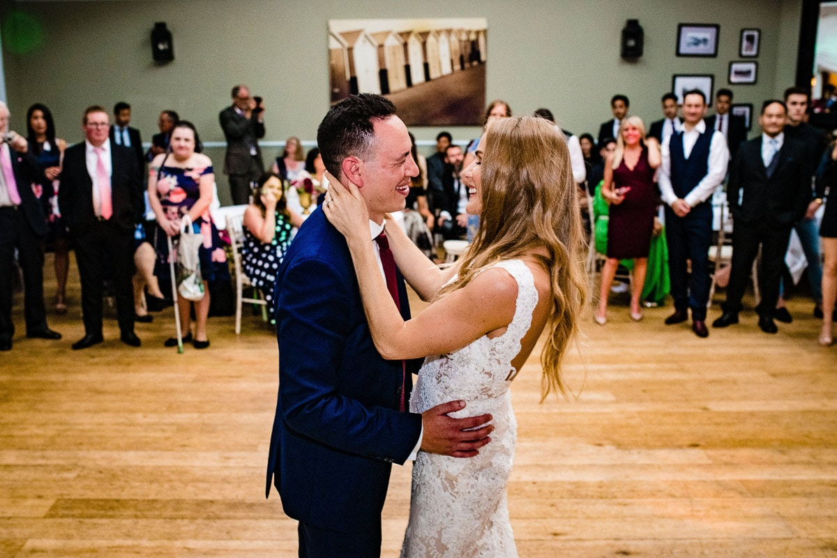 guests watch as bride and groom dance together