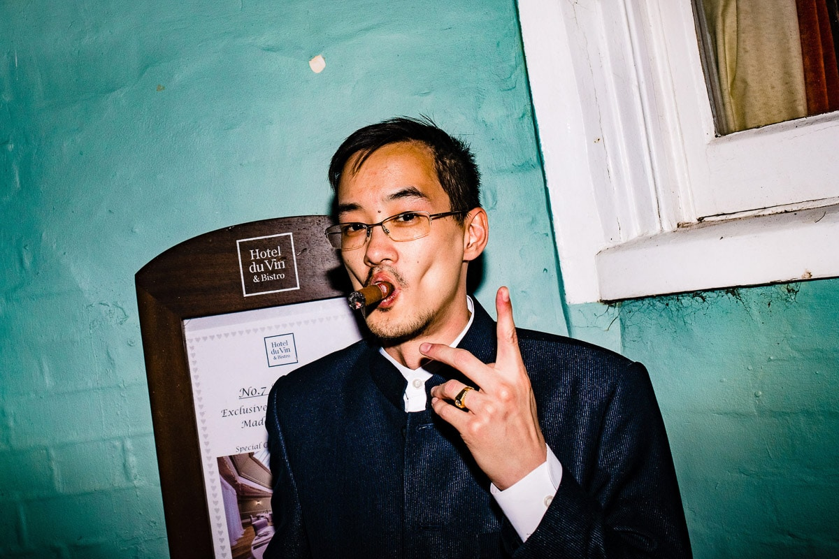 wedding guest smoking cigar portrait